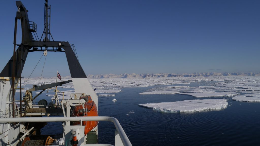 R/V Helmer Hanssen in drift ice with Svalbard at the horizon